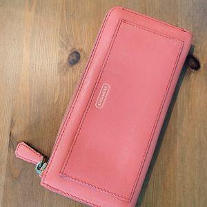Coral pink coach zip wallet
